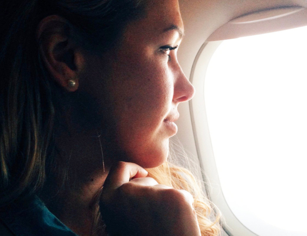 Chelsea looking out airplane window